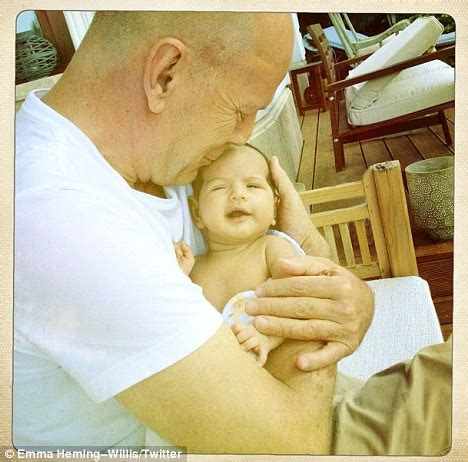 Bruce Willis cradles daughter Mabel Ray in adorable photo