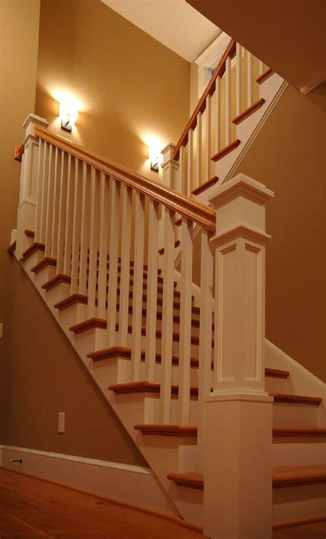 Painted newel posts and rails, stained treads and handrail